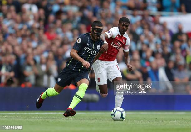 Ilkay Gundogan of Manchester City and Ainsley MaitlandNiles of Arsenal during the Premier League match between Arsenal FC and Manchester City at...