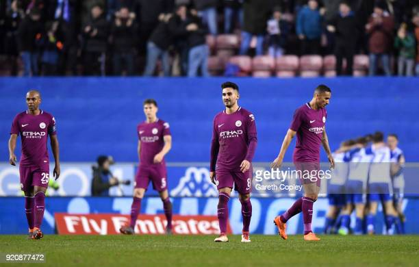 Ilkay Gundogan of Manchester City and his teammates look dejected after Wigan Athletic score their first goal during the Emirates FA Cup Fifth Round...