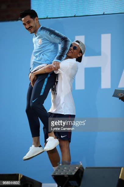 Ilkay Gundogan of Manchester City and Leroy Sane of Manchester City on stage during the Manchester City Trophy Parade in Manchester city centre on...