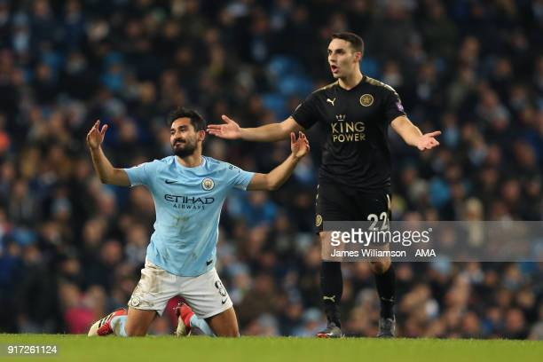 Ilkay Gundogan of Manchester City and Matty James of Leicester City react during the Premier League match between Manchester City and Leicester City...