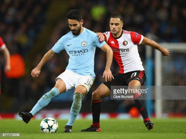 Ilkay Gundogan of Manchester City and Sofyan Amrabat of Feyenoord battle for possession during the UEFA Champions League group F match between...