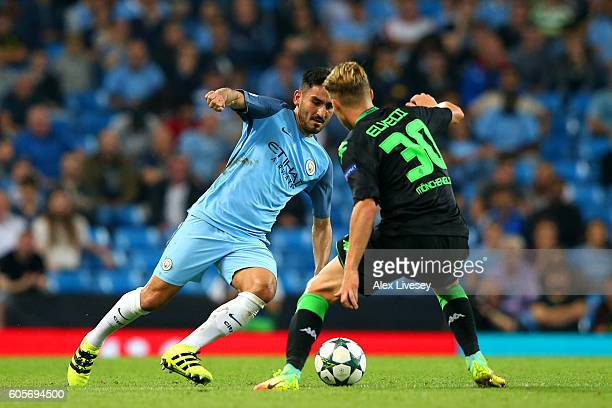 Ilkay Gundogan of Manchester City battles for the ball with Nico Elvedi of Borussia Moenchengladbach during the UEFA Champions League match between...