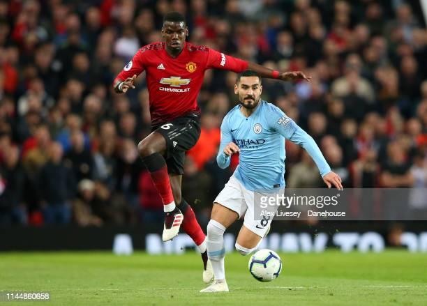 Ilkay Gundogan of Manchester City beats Paul Pogba of Manchester United during the Premier League match between Manchester United and Manchester City...