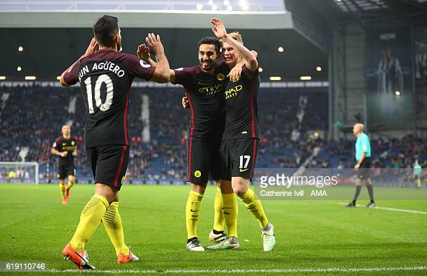 Ilkay Gundogan of Manchester City celebrates after he scores to make it 04 with Kevin De Bruyne and Sergio Aguero of Manchester City during the...
