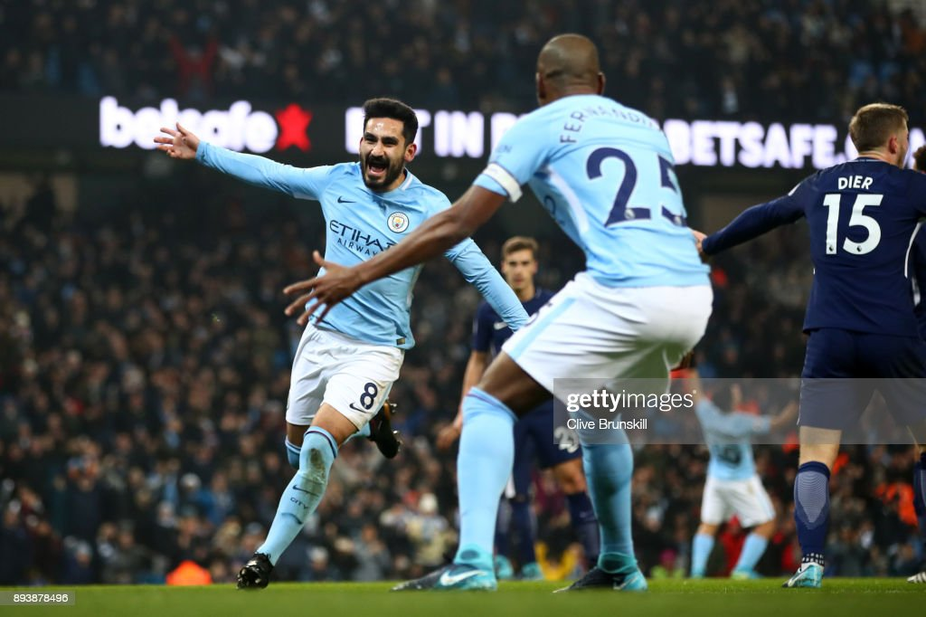 https://media.gettyimages.com/photos/ilkay-gundogan-of-manchester-city-celebrates-after-scoring-his-sides-picture-id893878496