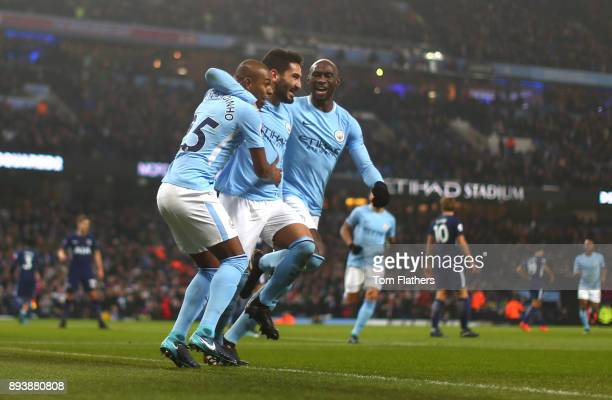 Ilkay Gundogan of Manchester City celebrates after scoring his sides first goal with his Manchester City team mates during the Premier League match...
