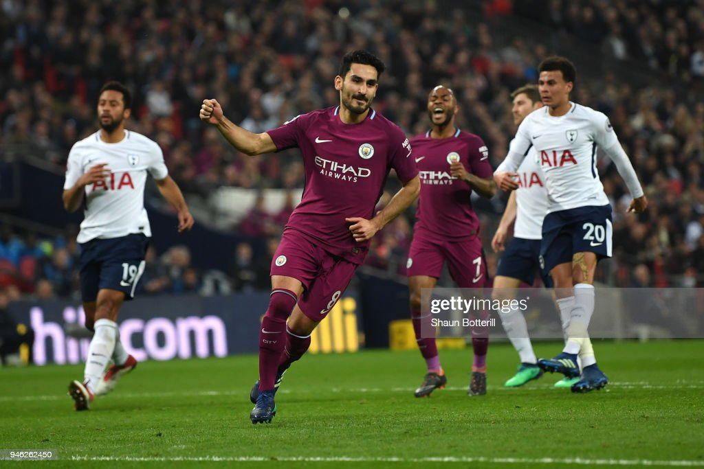 Ilkay Gundogan of Manchester City celebrates after scoring his sides second goal during the Premier League match between Tottenham Hotspur and Manchester City at Wembley Stadium on April 14, 2018 in London, England.