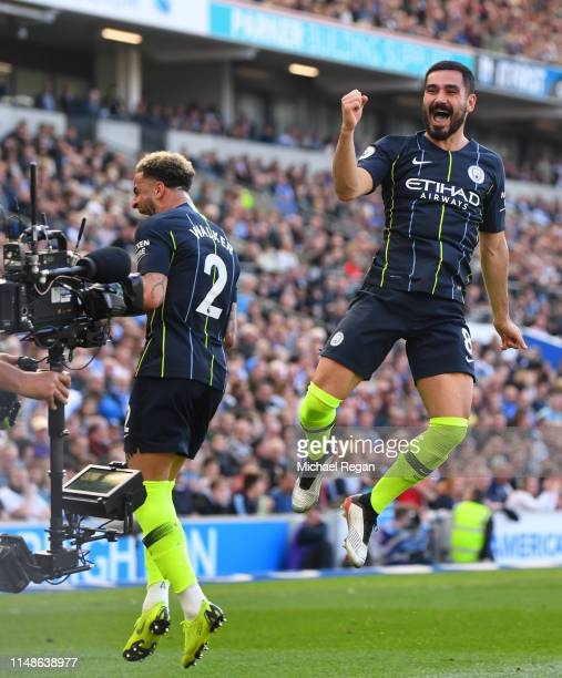 Ilkay Gundogan of Manchester City celebrates after scoring his team's fourth goal during the Premier League match between Brighton Hove Albion and...