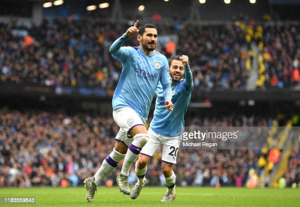 Ilkay Gundogan of Manchester City celebrates after scoring his team's third goal during the Premier League match between Manchester City and Aston...