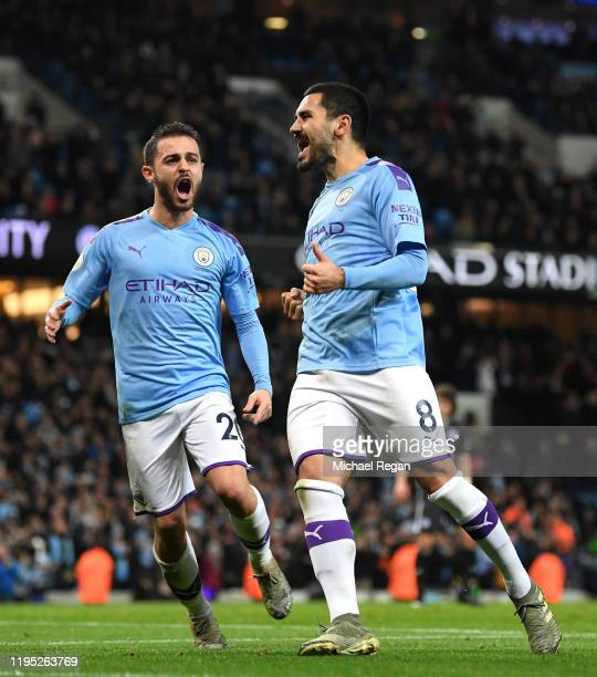 Ilkay Gundogan of Manchester City celebrates after scoring his team's second goal during the Premier League match between Manchester City and...