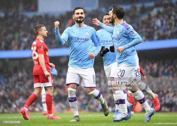 Ilkay Gundogan of Manchester City celebrates after scoring his team's first goal during the FA Cup Fourth Round match between Manchester City and...