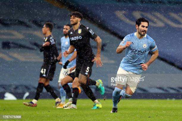 Ilkay Gundogan of Manchester City celebrates after scoring their team's second goal from the penalty spot during the Premier League match between...