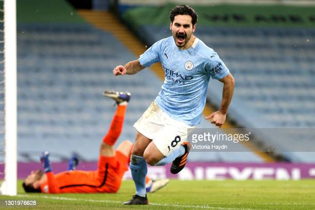 Ilkay Gundogan of Manchester City celebrates after scoring their side's second goal during the Premier League match between Manchester City and...