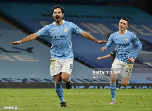 Ilkay Gundogan of Manchester City celebrates after scoring their side's third goal during the Premier League match between Manchester City and...