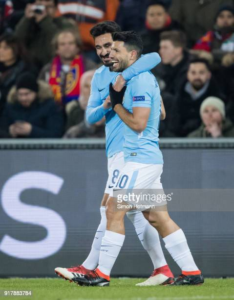 Ilkay Gundogan of Manchester City celebrates his team's first goal with his team mateSergio Aguero during the UEFA Champions League Round of 16 First...