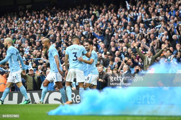 Ilkay Gundogan of Manchester City celebrates scoring his side's second goal with team mates during the Premier League match between Manchester City...