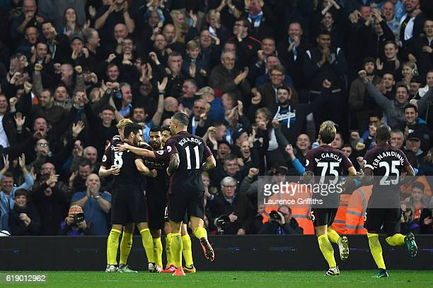 Ilkay Gundogan of Manchester City celebrates scoring his team's fourth goal with his team mates during the Premier League match between West Bromwich...