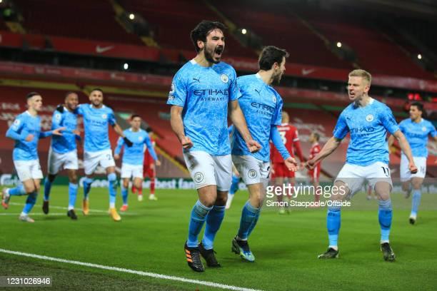Ilkay Gundogan of Manchester City celebrates scoring their opening goal with Bernardo Silva during the Premier League match between Liverpool and...
