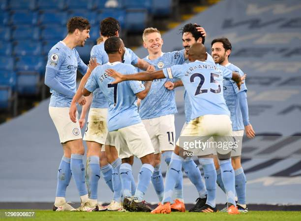 Ilkay Gundogan of Manchester City celebrates with John Stones, Bernardo Silva and team mates after scoring their side's second goal during the...