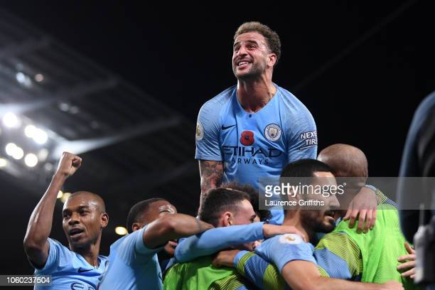Ilkay Gundogan of Manchester City celebrates with Kyle Walker of Manchester City and teammates after scoring his team's third goal during the Premier...