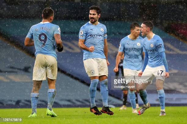 Ilkay Gundogan of Manchester City celebrates with Phil Foden after scoring their team's second goal during the Premier League match between...