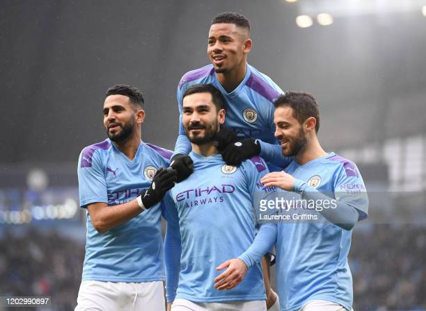 Ilkay Gundogan of Manchester City celebrates with Riyad Mahrez Gabriel Jesus and Bernardo Silva after scoring a penalty during the FA Cup Fourth...