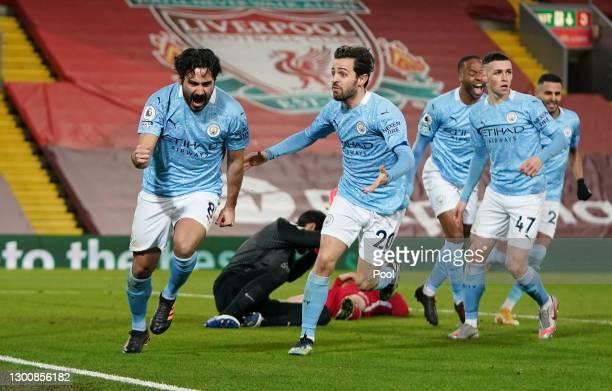 Ilkay Gundogan of Manchester City celebrates with team mate Bernardo Silva after scoring their side's first goal during the Premier League match...