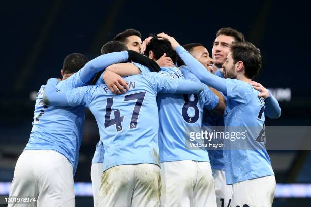 Ilkay Gundogan of Manchester City celebrates with team mates after scoring their side's third goal during the Premier League match between Manchester...