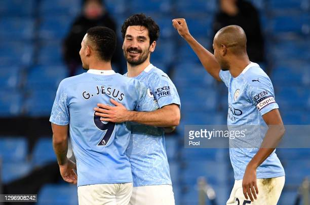 Ilkay Gundogan of Manchester City celebrates with team mates Gabriel Jesus and Fernandinho after scoring their side's second goal during the Premier...