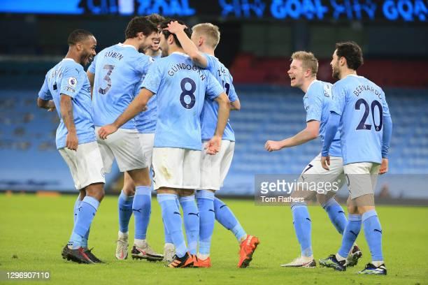 Ilkay Gundogan of Manchester City celebrates with team mates Raheem Sterling, Ruben Dias, Kevin De Bruyne and Bernardo Silva after scoring their...