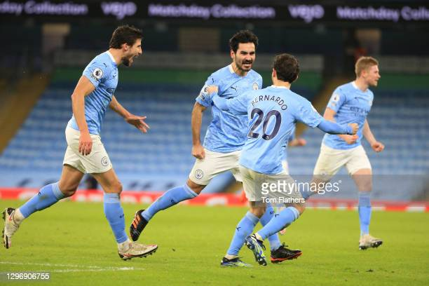 Ilkay Gundogan of Manchester City celebrates with team mates Ruben Dias and Bernardo Silva after scoring their side's second goal during the Premier...