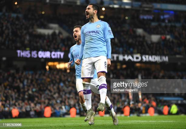 Ilkay Gundogan of Manchester City celebrates with teammate Bernardo Silva after scoring his team's second goal during the Premier League match...