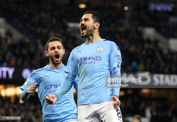 Ilkay Gundogan of Manchester City celebrates with teammate Bernardo Silva after scoring his team's second goal during the Premier League match...
