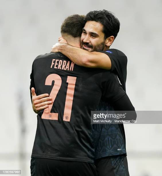 Ilkay Gundogan of Manchester City celebrates with teammate Ferran Torres after scoring his teams second goal during the UEFA Champions League Group C...