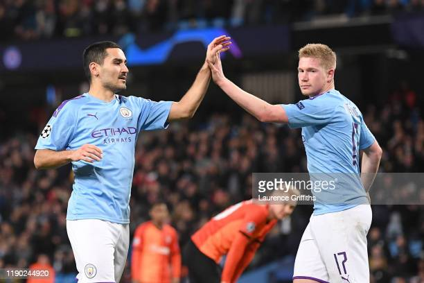 Ilkay Gundogan of Manchester City celebrates with teammate Kevin De Bruyne after scoring his team's first goal during the UEFA Champions League group...