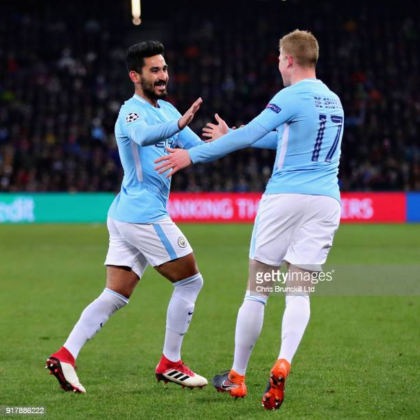 Ilkay Gundogan of Manchester City celebrates with teammate Kevin De Bruyne after scoring the opening goal during the UEFA Champions League Round of...