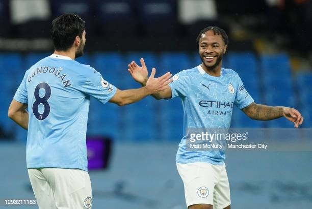 Ilkay Gundogan of Manchester City celebrates with teammate Raheem Sterling after scoring his team's first goal during the Premier League match...