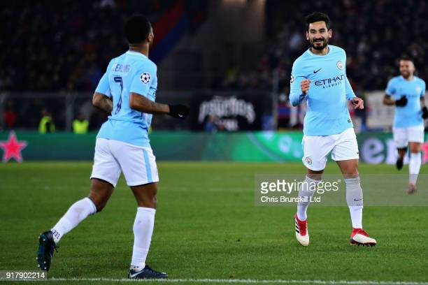 Ilkay Gundogan of Manchester City celebrates with teammate Raheem Sterling after scoring his sides fourth goal during the UEFA Champions League Round...