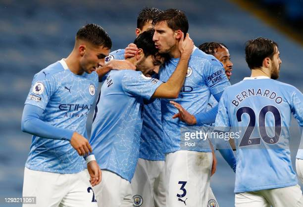 Ilkay Gundogan of Manchester City celebrates with teammate Ruben Dias after scoring their sides first goal during the Premier League match between...