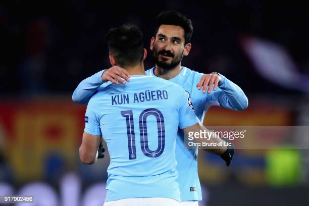 Ilkay Gundogan of Manchester City celebrates with teammate Sergio Aguero after scoring his sides fourth goal during the UEFA Champions League Round...