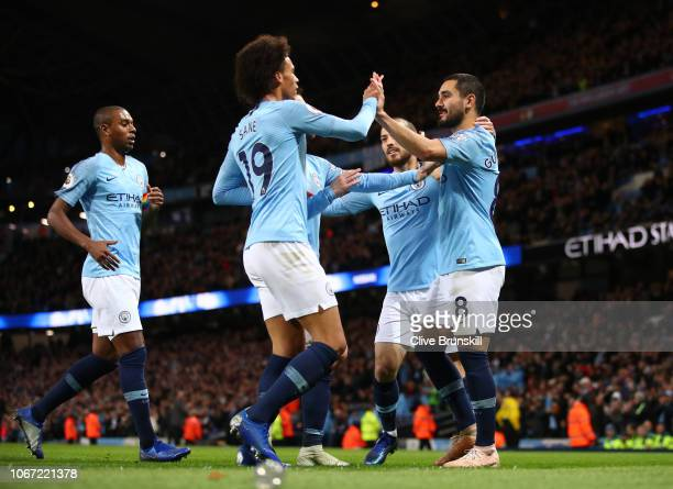 Ilkay Gundogan of Manchester City celebrates with teammates after scoring his team's third goal during the Premier League match between Manchester...