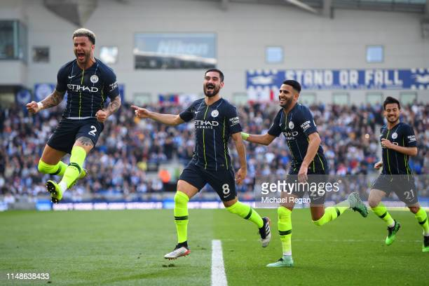 Ilkay Gundogan of Manchester City celebrates with teammates after scoring his team's fourth goal during the Premier League match between Brighton...