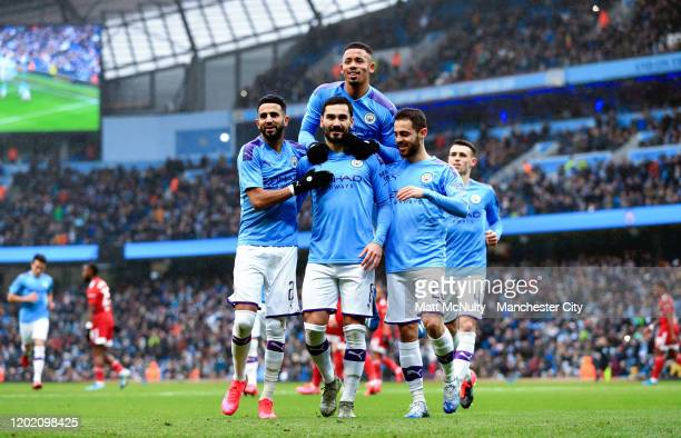 Ilkay Gundogan of Manchester City celebrates with teammates after scoring his teams first goal during the FA Cup Fourth Round match between...