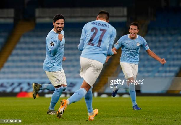 Ilkay Gundogan of Manchester City celebrates with teammates after scoring his sides second goal during the UEFA Champions League Group C stage match...