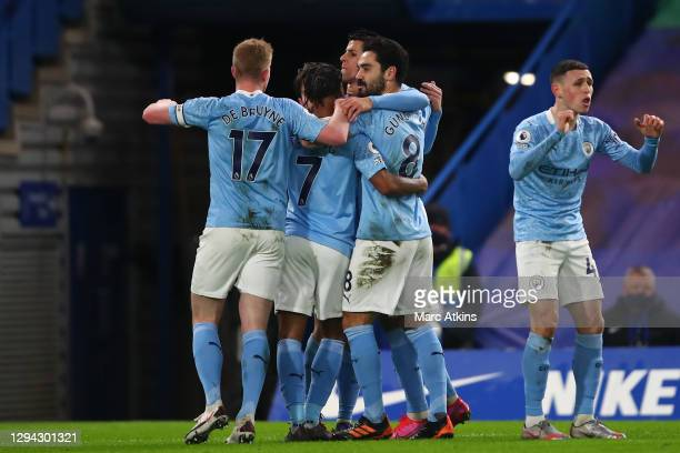 Ilkay Gundogan of Manchester City celebrates with teammates Kevin De Bruyne, Raheem Sterling, and Joao Cancelo after scoring his team's first goal...