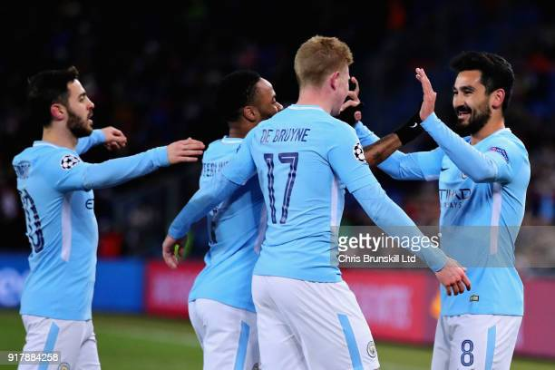 Ilkay Gundogan of Manchester City celebrates with teammates Kevin De Bruyne Raheem Sterling and Bernardo Silva after scoring the opening goal during...