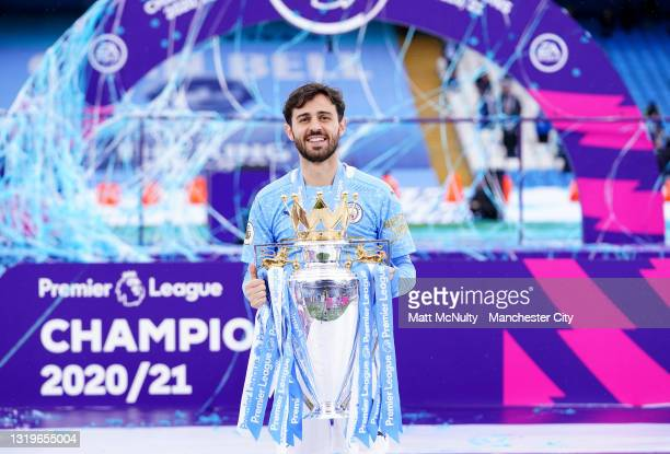 Ilkay Gundogan of Manchester City celebrates with the Premier League Trophy as Manchester City are presented with the Trophy as they win the league...