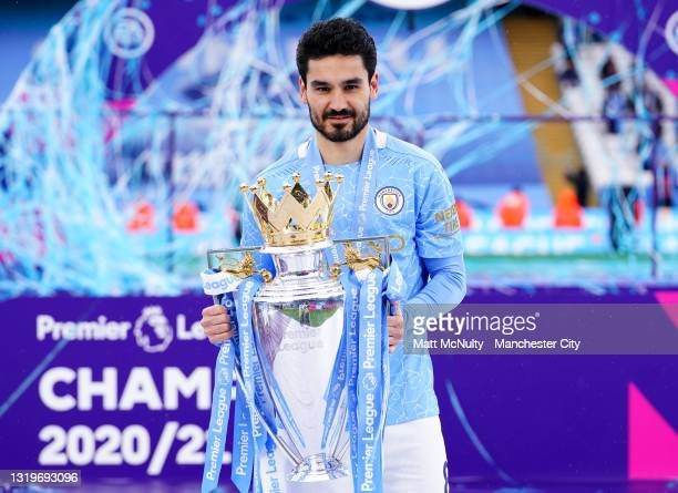 Ilkay Gundogan of Manchester City celebrates with the trophy during the Premier League match between Manchester City and Everton at Etihad Stadium on...
