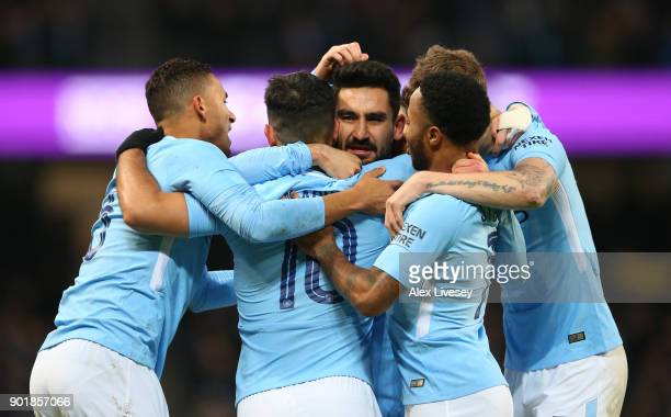 Ilkay Gundogan of Manchester City congratulates Sergio Aguero after he scored his team's first goal during The Emirates FA Cup Third Round match...
