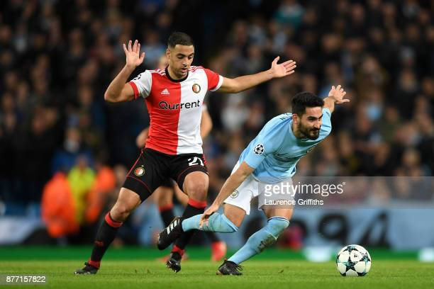 Ilkay Gundogan of Manchester City evades Sofyan Amrabat of Feyenoord during the UEFA Champions League group F match between Manchester City and...